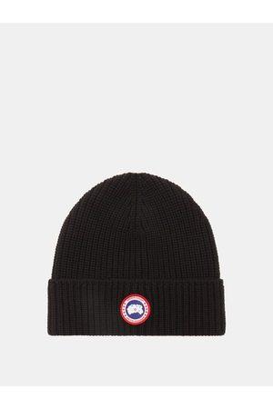 Canada Goose Bonnet en maille de laine mérinos côtelée à logo