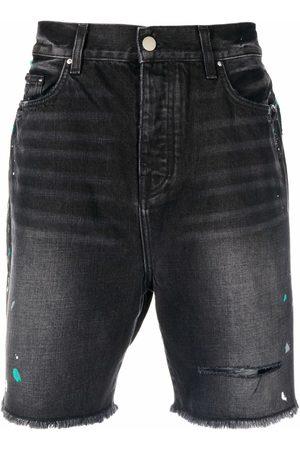 AMIRI Paint-splatter effect denim shorts