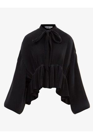 Balenciaga Blouse en jersey plissé à ourlet à basque