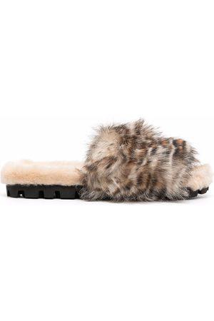 Miu Miu Claquettes en peau lainée à imprimé léopard