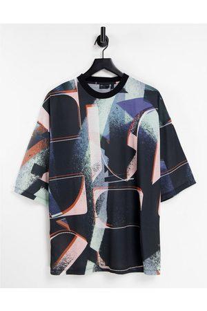 ASOS T-shirt oversize avec inscription sur l'ensemble