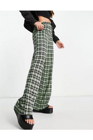ASOS ASOSDESIGN - Pantalon de jogging ample en jersey à carreaux - Fluo