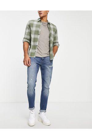 Hollister Jean super skinny effet vieilli et rapiécé - moyen teinté délavé