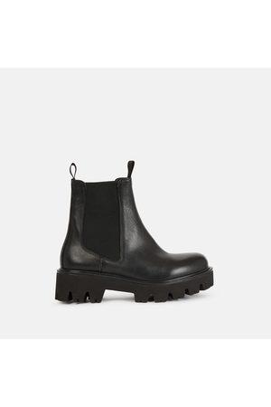 Minelli Boots cuir semelle crantée Fanchy