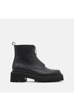 Minelli Boots en cuir, semelle crantée Stacy